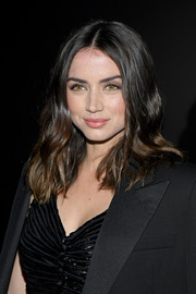 Ana de Armas wore her hair in face-framing waves at the Saint Laurent Fall 2020 show.