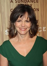 We caught a glimpse of Sally Field's gold leaf earrings on her 65th birthday.