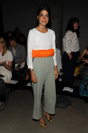 Leandra Medine chose a pair of taupe wide-leg pants to team with her top.