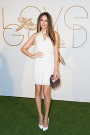 Louise Roe styled her dress with a sassy fringed and printed clutch.