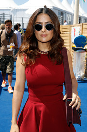 Salma Hayek wore modern round sunnies while visiting the American Pavilion in Cannes.