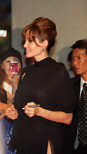 Angelina looked elegant with a textured updo and lash-skimming bangs.