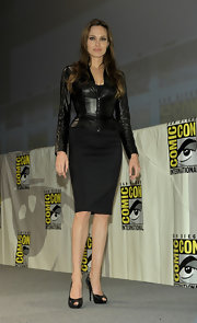 Angelina wore suede, patchwork-detailed peep toe pumps.