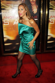 Leona paired her satin dress with sheer black tights and patent pumps.