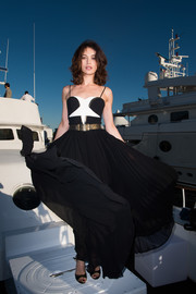 Olga Kurylenko was summer-glam in a star-motif, spaghetti-strap gown by Elie Saab at the Cannes Film Festival photocall for 'Salty.'