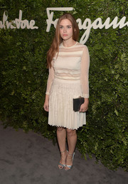 Holland Roden attended the Salvatore Ferragamo celebration of 100 years in Hollywood wearing a sheer-striped cream sweater.