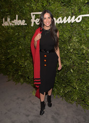 Demi Moore's black cutout boots echoed the ultra-modern style of her belt.