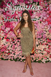 Stella Schnabel looked stunning in a gold beaded dress at the launch party of Salvatore Ferragamo's Signorina fragrance.