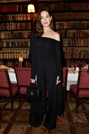 Michelle Monaghan paired her top with black wide-leg pants.