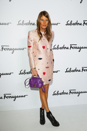 Anna dello Russo added an extra dose of color to her dress with a purple Ferragamo leather purse.