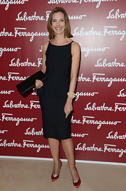 Carole Bouquet arrived at the Da Vinci exhibition at the Louvre wearing a lovely pair of red satin pumps with shiny crystal details.