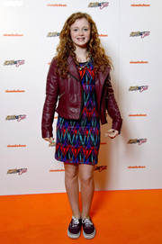 Maisie Smith looked very colorful at the 'Sam & Cat' premiere in her red leather jacket and print dress combo.