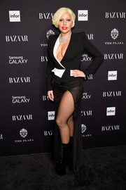 Lady Gaga showed major cleavage in a fitted black-and-white jacket by Alexandre Vauthier Couture at the Harper's Bazaar Icons event.