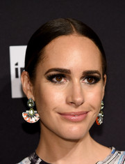 Louise Roe attended the Harper's Bazaar Icons event wearing a pair of Art Deco-chic dangling gemstone earrings.