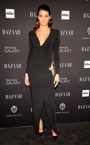 Isabeli Fontana kept it classic and sexy in a black wrap dress with a plunging neckline during the Harper's Bazaar Icons event.