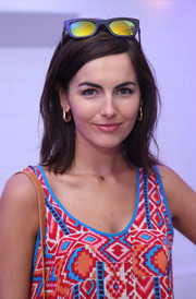 Camilla Belle styled her look with a pair of gold hoop earrings.