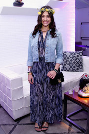 Emmy Rossum looked Coachella-ready in a denim jacket layered over a printed maxi dress.