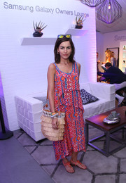 Camilla Belle topped off her ensemble with a fringed shoulder bag.