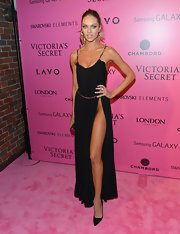Candice tempered the sexiness of her slit-to-there dress with classic pointy-toe pumps.