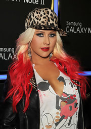 Christina capped her fiery ombre locks off with an attitude-infused leopard-print hat.