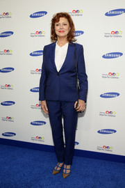 Susan Sarandon styled her suit with a pair of strappy color-block pumps.