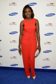 Estelle attended the Hope for Children Gala looking bright in a sleeveless red jumpsuit by Opening Ceremony.