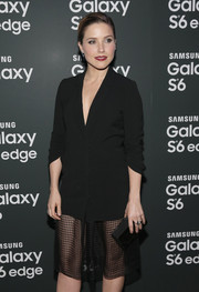 Sophia Bush topped off her all-black look with a Rauwolf box clutch.