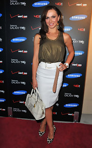 Karina Smirnoff added sizzle to her step at the Samsung Galaxy Tab launch with a pair of leopard print pumps. The exotic heels were the perfect finish to her shimmery olive tank and white pencil skirt.