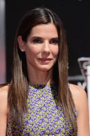 Sandra Bullock styled her hair in sleek straight layers for her hand and footprint ceremony.