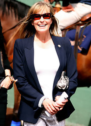 Bo Derek opted for a simple navy blazer and a white blouse for the Santa Anita Derby.