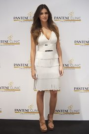 Sara Carbonero wore this white fringed dress to the Pantene event.