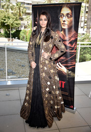 Aishwarya Rai arrived for the 'Sarbjit' photocall looking regal in a floor-length square-patterned coat by Rohit Bal.