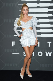 Paris Hilton attended the Savage X Fenty show wearing a ruffled ice-blue cutout dress.