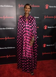 Iman looked vibrant in a pink and black Duro Olowu polka-dot maxi dress at the Save the Children Illumination Gala.