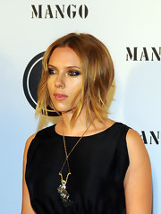 Scarlett Johansson showed off her freshly cropped honey blond locks while hitting the Mango Fashion Awards. The actress always keeps her look fresh with fresh hairstyles and colors.