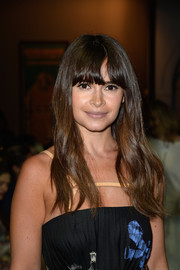 Miroslava Duma looked youthful with her barely-there waves and eye-grazing bangs at the Schiaparelli Couture fashion show.