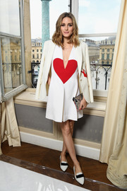 Olivia Palermo paired her look with a silver paint-splatter clutch by Meli Melo.
