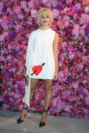 Pixie Lott coordinated her frock with a pair of heart-embellished pumps.