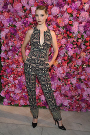 Anya Taylor-Joy donned a printed zip-up vest by Schiaparelli for the label's Couture Fall 2018 show.