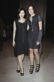 Bettina donned a little black dress with leather sleeves and a zip front for Fashion Week in Germany.