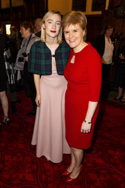 Saoirse Ronan attended the Scotland premiere of 'Mary Queen of Scots' wearing a tartan capelet over a pink gown.