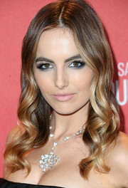 Camilla Belle adorned her bare neckline with a stunning diamond chandelier necklace.