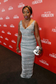 Estelle got majorly glam in a silver column dress rendered in irregular, beaded stripes for the SAG Foundation 30th anniversary celebration.