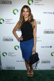 Sofia Vergara polished off her look with a classic black Hermes Kelly.