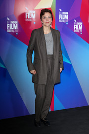 Maggie Gyllenhaal opted for an oversized gray pantsuit by Rachel Comey when she attended the BFI London Film Festival Screen Talk.