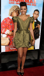 Jessica Lucas made a statement in a unique gold origami-inspired dress with poof sleeves and a pleated skirt.