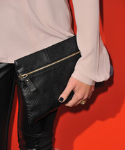 Nicole Gale Anderson accessorized with an edgy-stylish black snakeskin clutch at the 'Pretty Little Liars' Halloween episode screening.