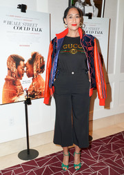 Tracee Ellis Ross added an extra pop of color with a pair of green knot-detail peep-toes by Gucci.