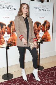 Debby Ryan tied her look together with a pair of white ankle boots.