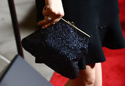 Juno Temple added some sparkle to her red carpet look with this over-sized beaded clutch.